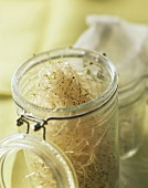 Home-grown alfalfa sprouts in opened preserving jar