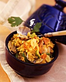 Moroccan spiced rice with mussels in blue bowl