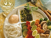 Vegetable fondue with rice noodles & three sauces on plate