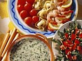 Cheese & tortellini fondue & shrimps, tomatoes, rocket salad