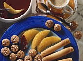 Cappuccino fondue with orange segments, amarettini & wafers