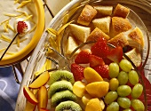 Yoghurt fondue with mixed fruits & pieces of fritter