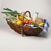Vegetables, fruit, milk & bread in a basket