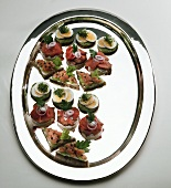 Assorted canapés (roast beef, salmon, egg) on tray