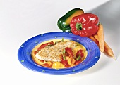 Escalope with pepper sauce on plate; peppers, carrots