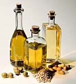 Three oil bottles: olive oil, sunflower oil & peanut oil