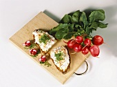 Rye bread with raw radish and apple salad on wooden board