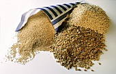 Various types of cereal, including millet in paper bag