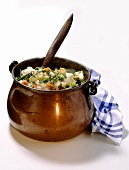 Witch's stew - vegetable stew in small copper cauldron