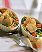 Poultry parcels with wine & mustard sauce on vegetables