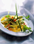 Avocado segment with tomato & orange dressing and capers
