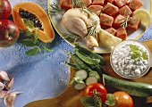 Still life: meat, poultry, vegetables, cottage cheese, papaya
