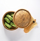 Asian steaming basket with savoy rolls, napkin