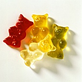 Four gummi bears (jelly bears) in various colours