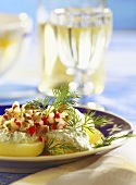 Matje herring tartare on potatoes with dill cream & dill tips