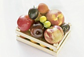 Various types of stone fruit in a crate
