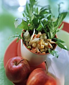Rocket and apple salad with pine nuts and parmesan