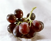 Red grapes on a light background