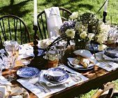 Laid table in open air with pastries, iced tea & lilac