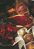 Still life with minced beef, two beefsteaks & poultry