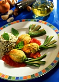 Courgette flowers with veal stuffing, rice and tomato sauce