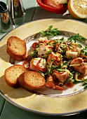 Shrimps with courgettes in lemon sauce; baguette slices