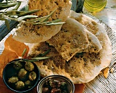 Turkish flat bread with sesame & black cumin; olives