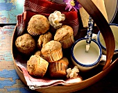 Savoury muffins with cheese, buttermilk & cloth on tray