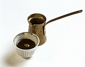 Turkish coffee in cup and copper pot
