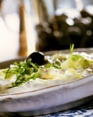 Tzaziki with fresh mint and olive on plate