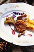 Lamb with mushrooms and red berry sauce; Scot's pine cones