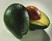 Avocado, halved, with stone