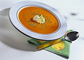 Carrot soup with curried cream and chopped parsley