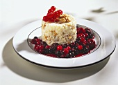 Walnut rice with hot berries on white plate