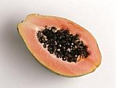Halved papaya on light background