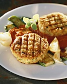 Vegetable cakes with grilled courgettes and tomato sauce