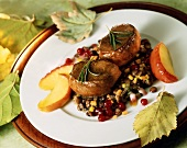 Venison steaks with bacon lentils,apple slices & cranberries