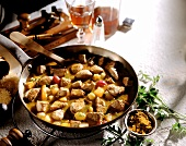 Curried veal fillet with fruit in frying pan