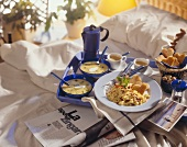 Breakfast in bed: scrambled egg, fruit cocktails, coffee, toast