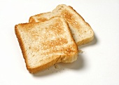 Two slices of toast on a light background