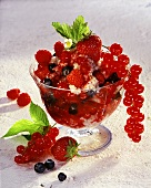 Mixed berries with buckwheat pudding in glass bowl