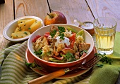 Turkey and sauerkraut goulash with peppers and apples