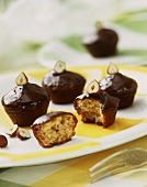 Cognac muffins with chocolate icing and hazelnuts