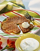 Heart-shaped Brussels waffles with icing sugar and cream