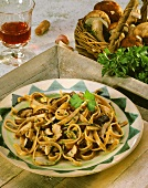 Wholemeal ribbon pasta with ceps and parsley on plate
