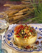 Baked celeriac stuffed with green spelt and tomatoes