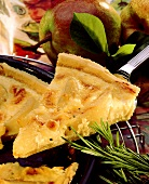 Cheese tart with pears on cake slice above baking dish