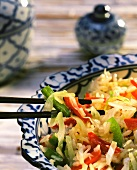 Rice stew with cabbage and peppers on Asian plate
