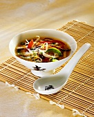 Sweet and sour vegetable soup with glass noodles and tofu