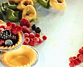 Still life with pastry, frozen berries, ravioli & tortellini